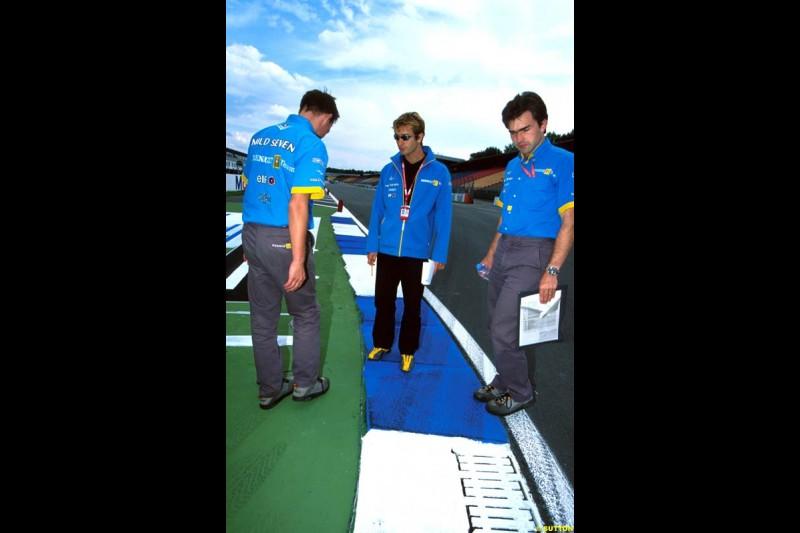 Renault team members inspect the new Hockenheim circuit. German Grand Prix, Round 12.