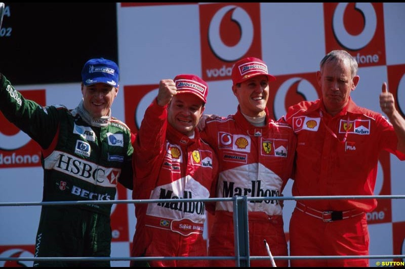 Italian Grand Prix, Round 15 Podium. 1-Michael Schumacher, Ferrari. 2-Rubens Barrichello, Ferrari. 3-Eddie Irvine, Jaguar.