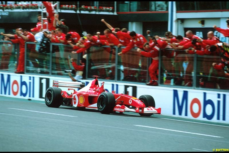 Michael Schumacher, Ferrari, crosses the line to win the French Grand Prix, Round 11.