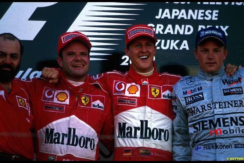 Japanese Grand Prix, Round 17 Podium. 1-Michael Schumacher, Ferrari. 2-Rubens Barrichello Ferrari. 3-Kimi Raikkonen, McLaren.