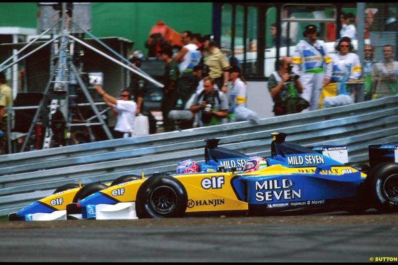 Jenson Button, Renault, passes team mate Jarno Trulli, during the European Grand Prix, Round 9.