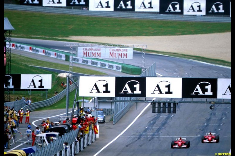 Michael Schumacher, Ferrari, passes team mate Rubens Barrichello at the final corner to win the Austrian Grand Prix, Round 6.