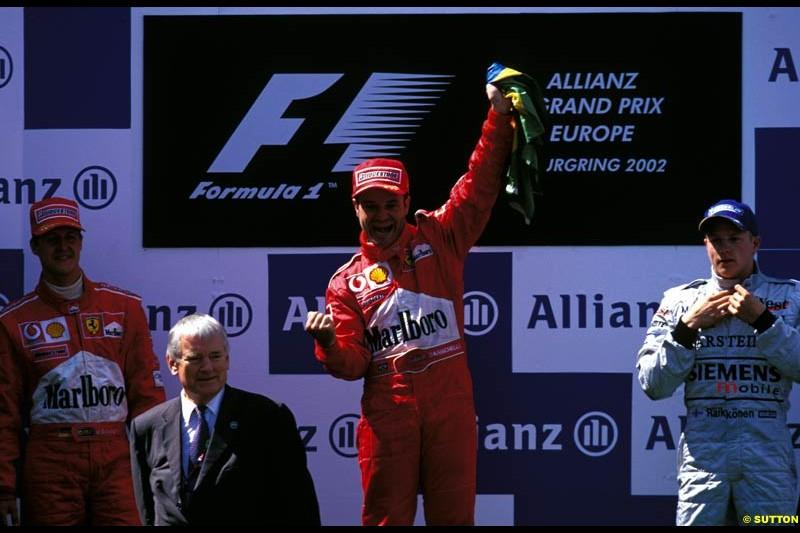 European Grand Prix, Round 9 Podium. 1-Rubens Barrichello, Ferrari. 2-Michael Schumacher, Ferrari. 3-Kimi Raikkonen, McLaren.