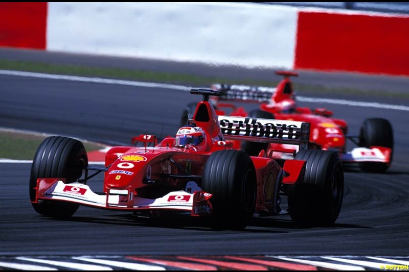 Rubens Barrichello, Ferrari, leads Michael Schumacher, Ferrari, during the European Grand Prix, Round 9.