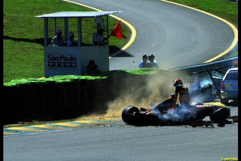 Enrique Bernoldi, Arrows, climbs from his car after a warm up crash. Brazilian Grand Prix, Round 3.