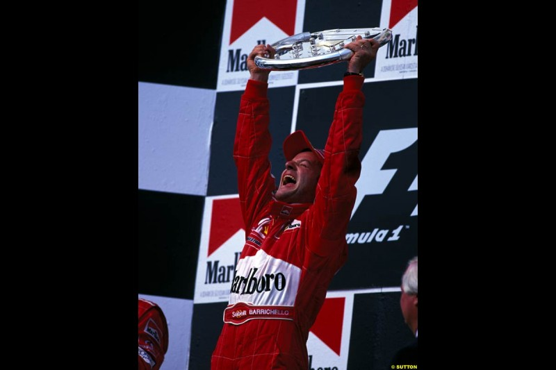 Rubens Barrichello, Ferrari, celebrates victory at the Hungarian Grand Prix, Round 13.