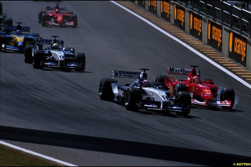 Juan Pablo Montoya, Williams, and Michael Schumacher, Ferrari, battle for the lead of the Brazilian Grand Prix, Round 3.