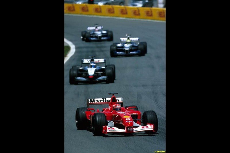 Michael Schumacher, Ferrari, leads Kimi Raikkonen, McLaren. Canadian Grand Prix, Round 8.