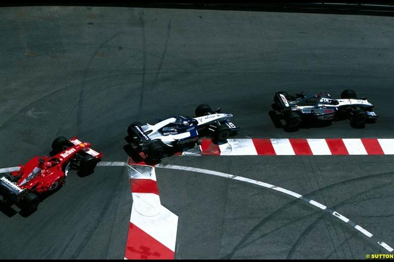 David Coulthard, McLaren, is chased by Juan Pablo Montoya, Williams, and Michael Schumacher, Ferrari. Monaco Grand Prix, Round 7.