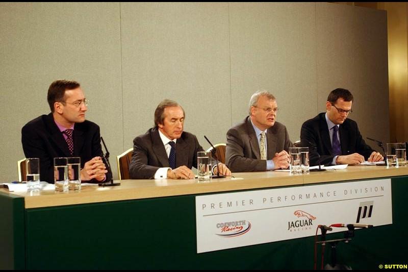 Tony Purnell, Sir Jackie Stewart, Richard Parry-Jones and Stuart Dyble at the Jaguar Media Briefing. London Landmark Hotel, England. November 26th 2002.