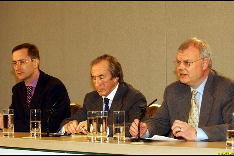 Tony Purnell, Sir Jackie Stewart and Richard Parry-Jones at the Jaguar Media Briefing. London Landmark Hotel, England. November 26th 2002.