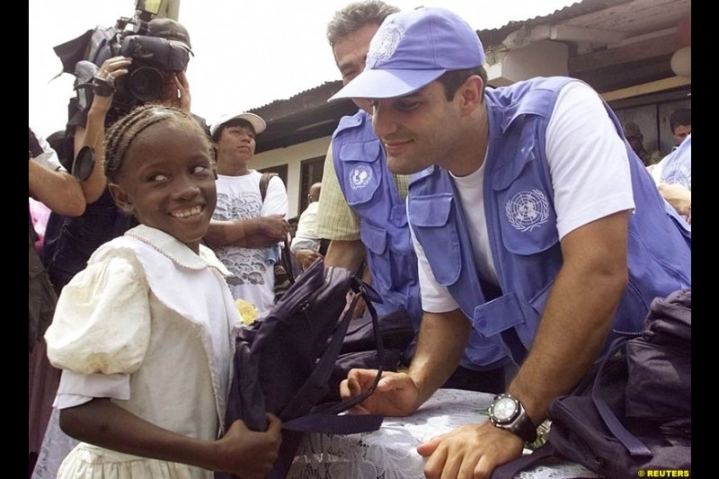 Juan Pablo Montoya during a visit at the impoverished village of Napipi, in northwestern Choco Province, November 22, 2002. Choco is one of Colombia's poorest regions and is hard hit by a 38-year old guerrilla war that kills thousands of people every year. Montoya is visiting Napipi as part of a campaign to donate money to poor children.