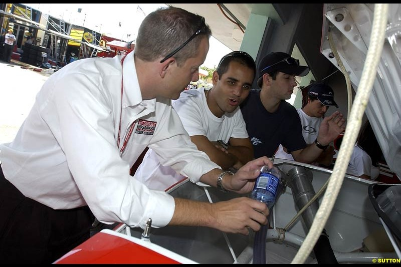 Juan Pablo Montoya chats with the Ganassi crew at the final race of the NASCAR season. Ford 400, Homestead, Florida USA. November 16th 2002.
