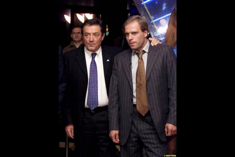 Russian Formula One driver Sergei Zlobin (R) and Minardi managing director Giancarlo Minardi pose for photographers at a night club in Moscow late November 14, 2002.
