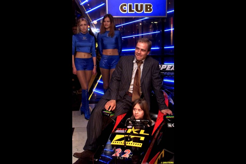 Russian Formula One driver Sergei Zlobin poses for photographers in a night club in Moscow late November 14, 2002.
