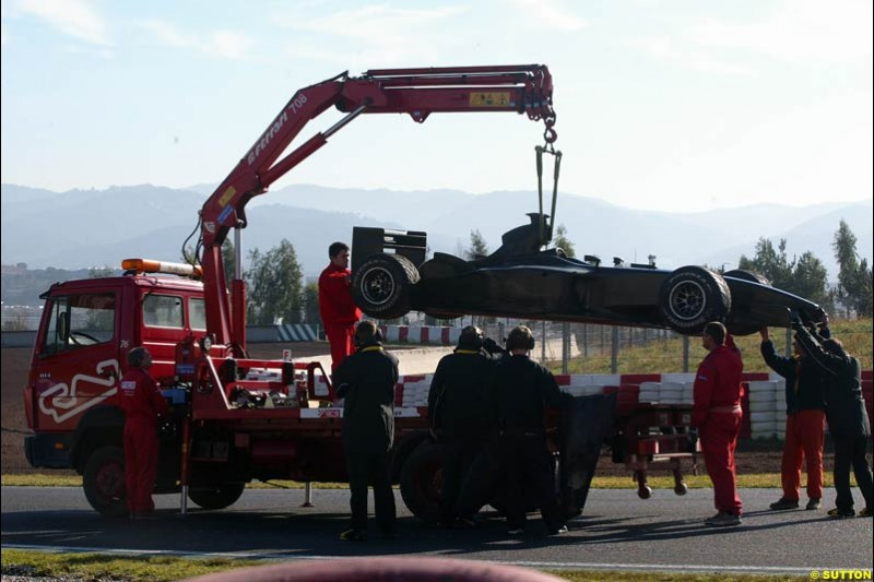 Giancarlo Fisichella's Jordan is towed back to the pits after a mechnical failure. Barcelona, Spain. January 20th 2003.