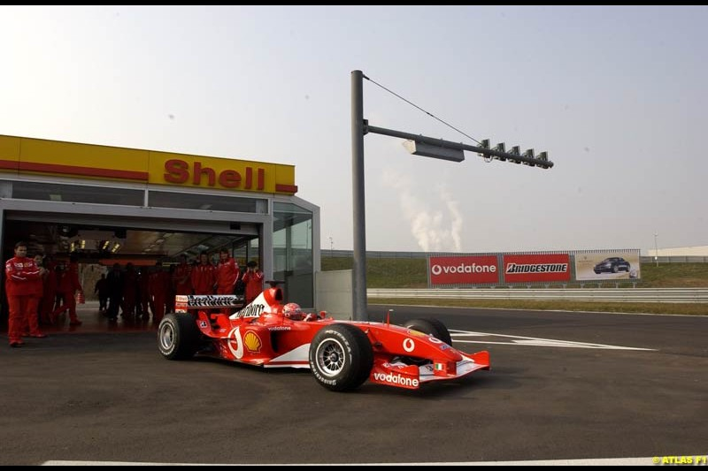 Michael Schumacher tests the new Ferrari F2003-GA at the Fiorano circuit in Italy. 11th February 2003.