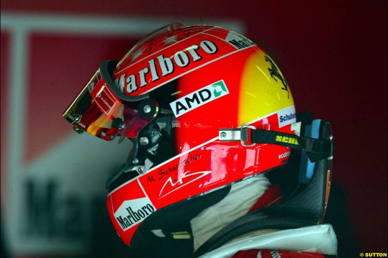Michael Schumacher tries the HANS device at the Circuit de Catalunya. Barcelona, Spain. February 3rd, 2003.