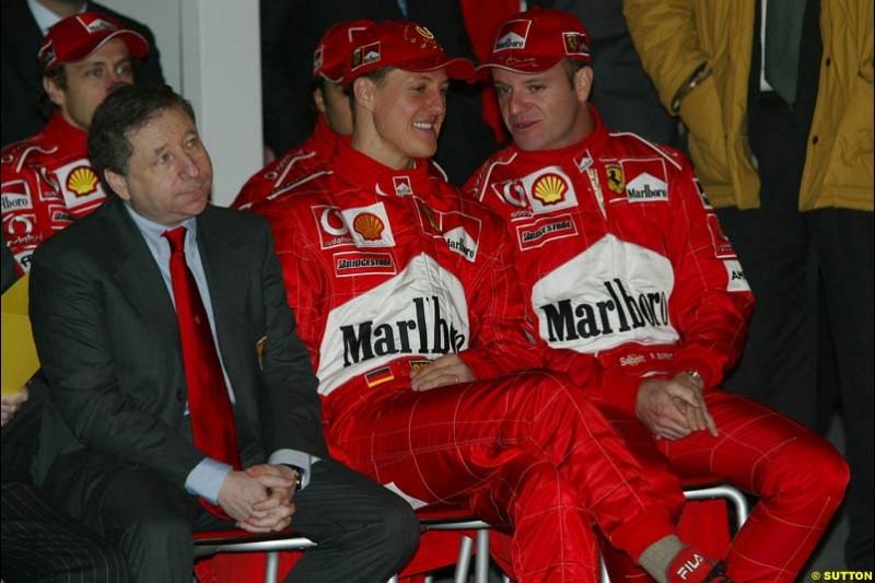 Jean Todt, Michael Schumacher and Rubens Barrichello. Ferrari launch the 2003 challenger, the F2003-GA, at Maranello, Italy. February 7th 2003.