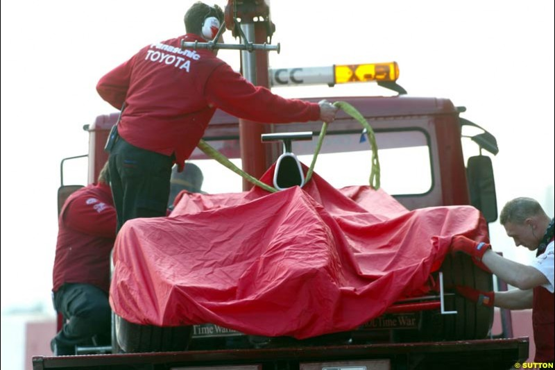 Olivier Panis's Toyota car towed away during testing at Barcelona, Spain. 18th February 2003.