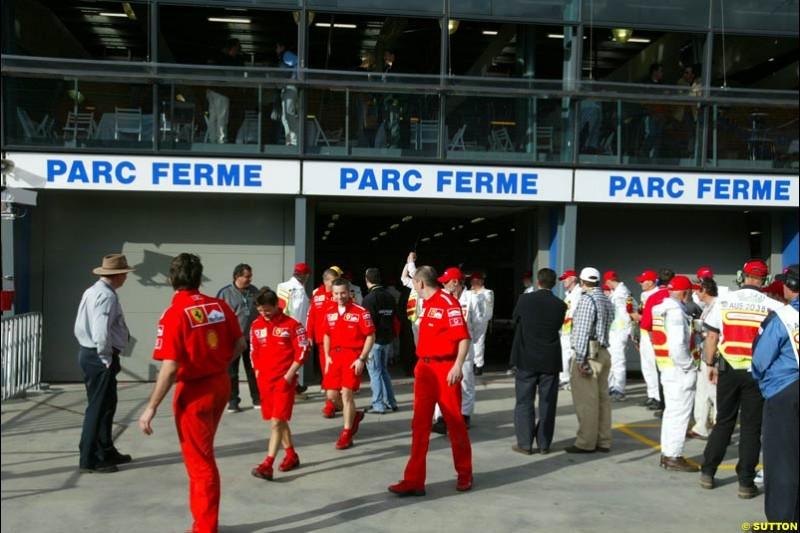 Mechanics leave Parc Ferme. Saturday, Australian GP, March 8th 2003.