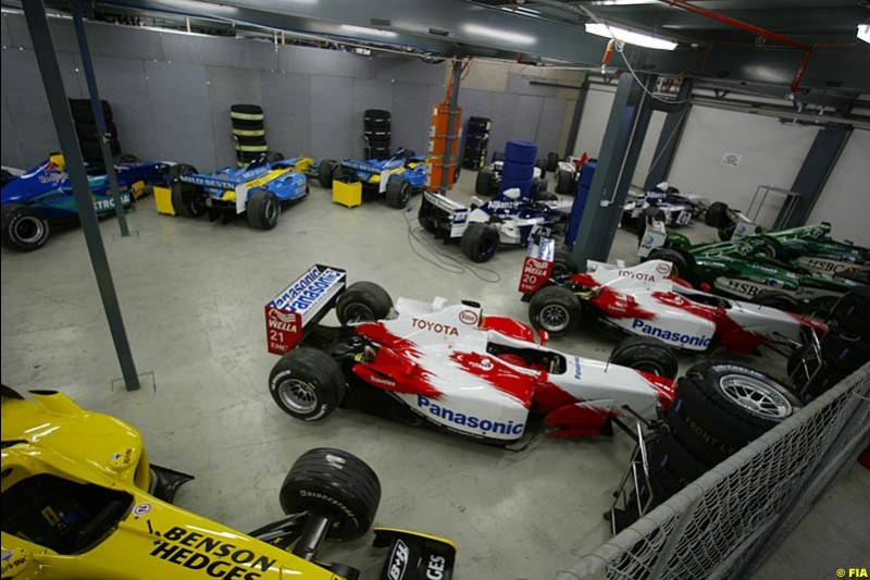 All 18 cars (without the two Minardis) are held at Parc Ferme overnight prior to the race. Saturday, Australian GP, March 8th 2003. Photo © FIA