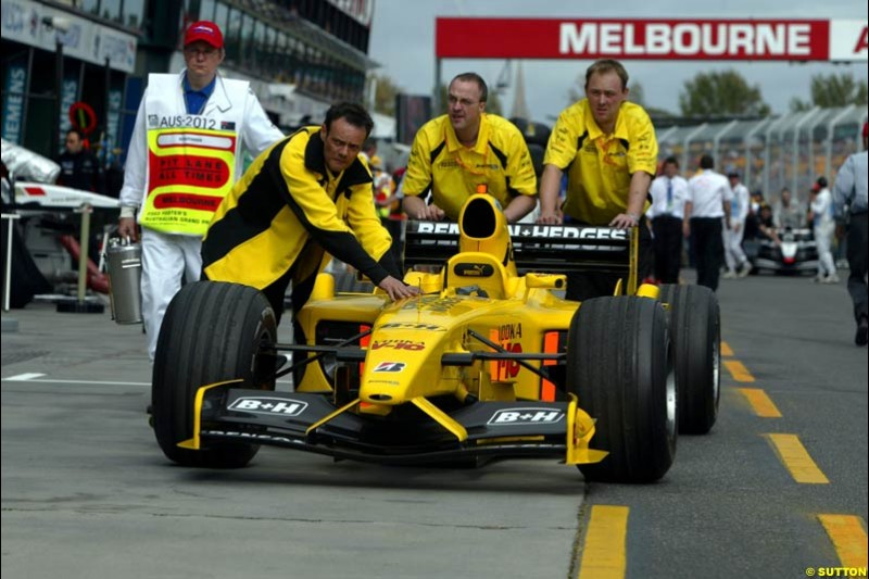The Jordan team bring the car back to the garage under the supervision of the scrutineer after qualifying for the Australian GP. Melbourne, March 8th 2003.