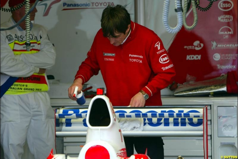 The Toyota mechanic works on the car in Parc Ferme after qualifying for the Australian GP. Melbourne, March 8th 2003.