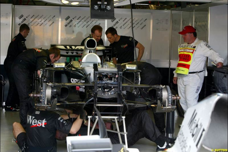 The McLaren mechanics work in Parc Ferme under the watchful eyes of the scrutineers after qualifying for the Australian GP. Melbourne, March 8th 2003.