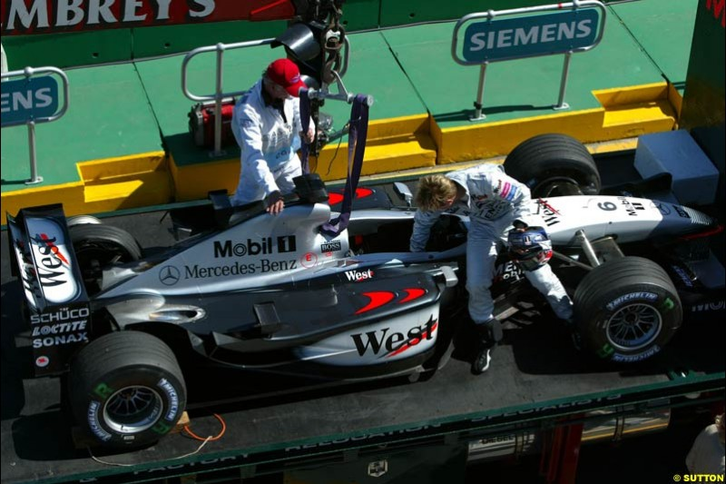 Kimi Raikkonen blows a tyre during Saturday's qualifying for the Australian GP. Melbourne, March 8th, 2003.
