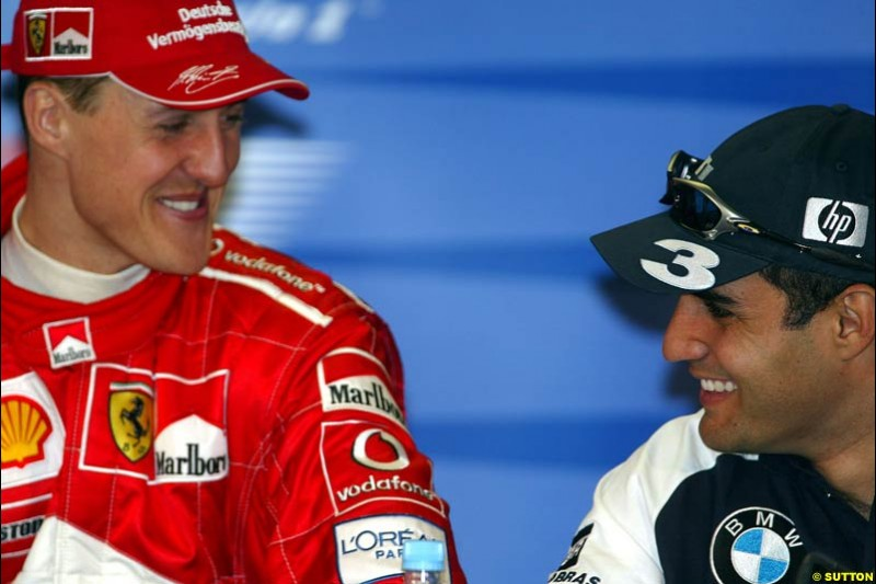Michael Schumacher, Ferrari, and Juan Pablo Montoya, Williams, at the post-qualifying press conference after Saturday's qualifying for the Australian GP. Melbourne, March 8th, 2003.