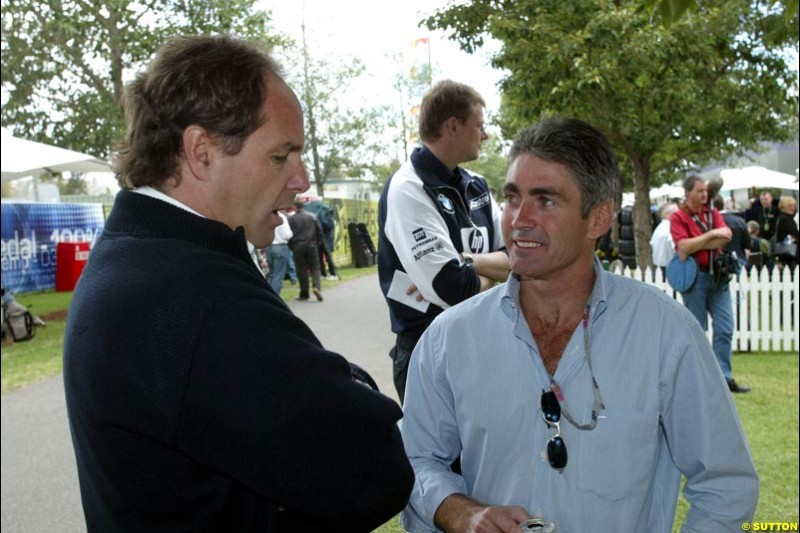 BMW's Gerhard Berger talks to World Champion Mick Doohan at the paddock during Saturday's qualifying for the Australian GP. Melbourne, March 8th, 2003.