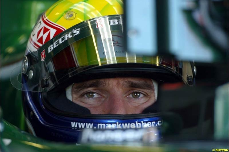 Mark Webber, Jaguar, prepares for Saturday's qualifying for the Australian GP. Melbourne, March 8th, 2003.