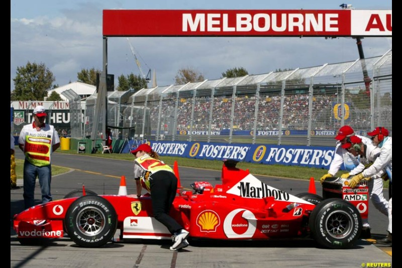 Michael Schumacher's Ferrari pushed to the Parc Ferme garage after Saturday's qualifying for the Australian GP. Melbourne, March 8th 2003.