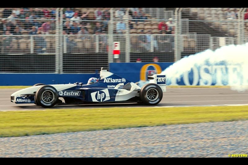 Juan Pablo Montoya's Williams BMW smoking during Saturday's free practice for the Australian GP. Melbourne, March 8th 2003.