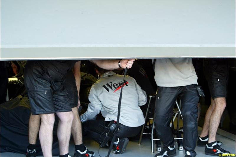 McLaren work on Kimi Raikkonen's McLaren in the garage during Saturday practice. Australian GP, Melbourne. March 8th 2003.