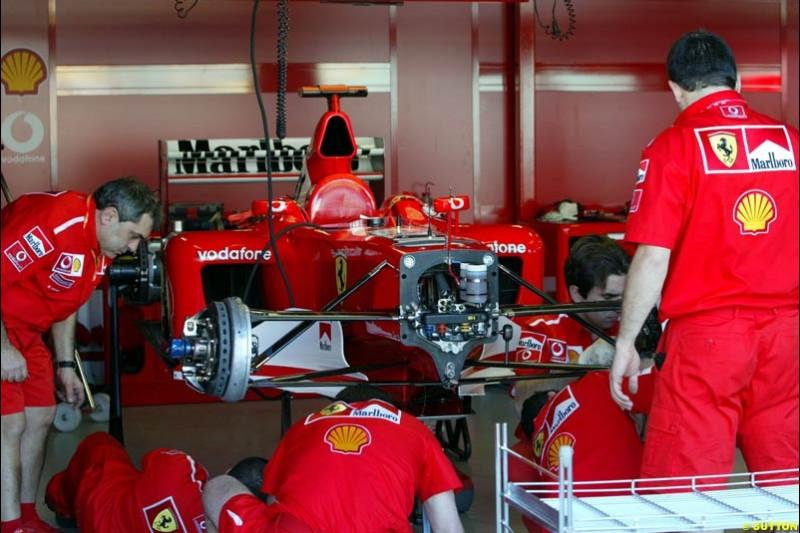 Ferrari working on Michael Schumacher's damaged car. Saturday practice. Australian GP, Melbourne. March 8th 2003.