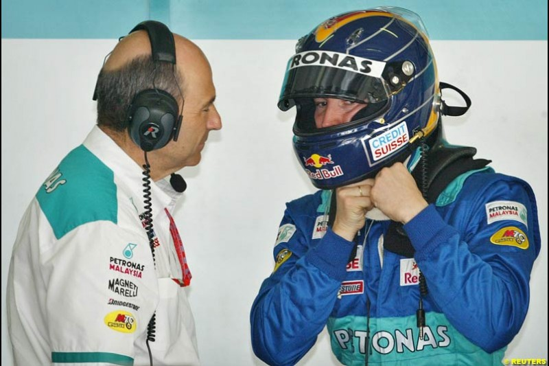 Peter Sauber and Heinz Harald Frentzen during Friday qualifying for the Malaysian GP. Sepang, March 21st 2003.
