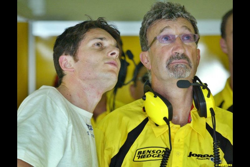 Giancarlo Fisichella and Eddie Jordan during Friday qualifying for the Malaysian GP. Sepang, March 21st 2003.