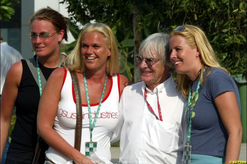 Bernie Ecclestone and fans. Friday qualifying for the Malaysian GP. Sepang, March 21st 2003.