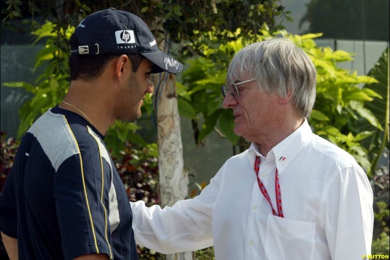 Juan Pablo Montoya, Williams, and Bernie Ecclestone after Friday qualifying for the Malaysian GP. Sepang, March 21st 2003.