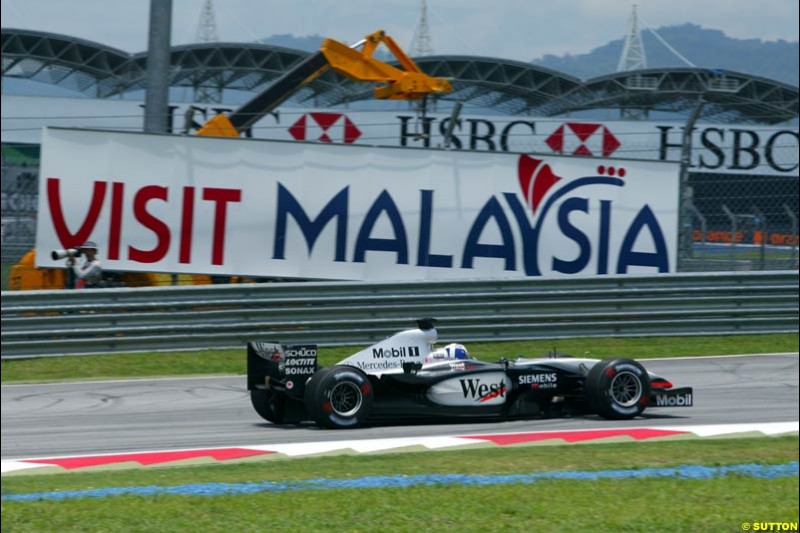 David Coulthard, McLaren, during Friday qualifying for the Malaysian GP. Sepang, March 21st 2003.