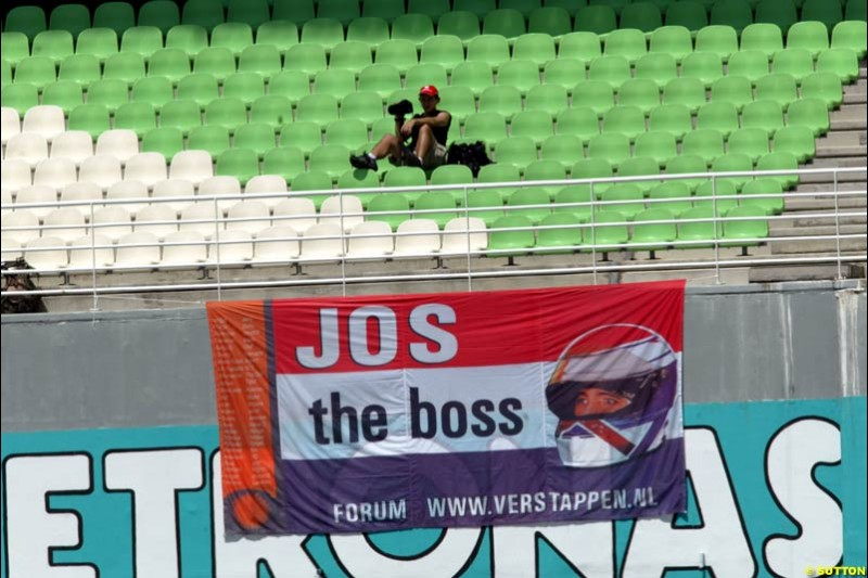 Jos Verstappen fans at the Malaysian GP. Sepang International Circuit, March 21st 2003.