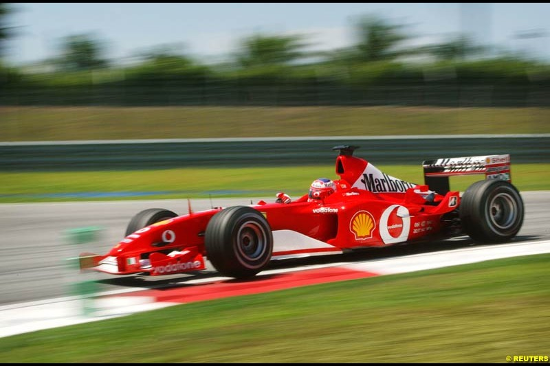 Rubens Barrichello, Ferrari, during Friday free practice at Sepang International Circuit. Malaysian GP, March 21st 2003.
