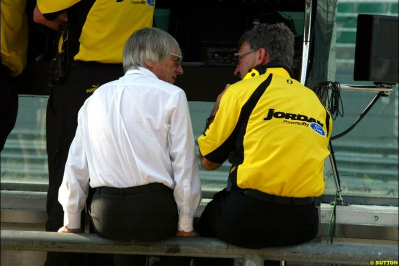 Bernie Ecclestone talks to Eddie Jordan during Friday morning testing at Sepang International Circuit. Malaysian GP, March 21st 2003.