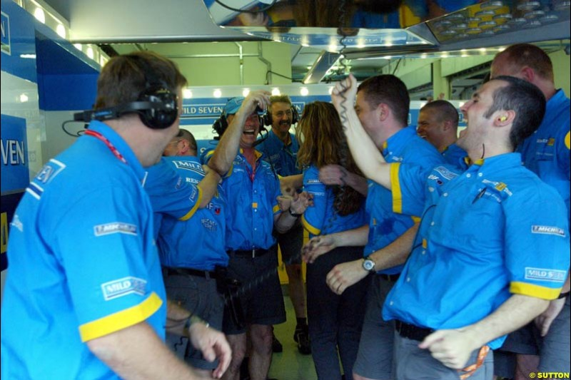 Renault team celebrates their all front row after Saturday qualifying for the Malaysian GP. Sepang, March 22nd 2003.