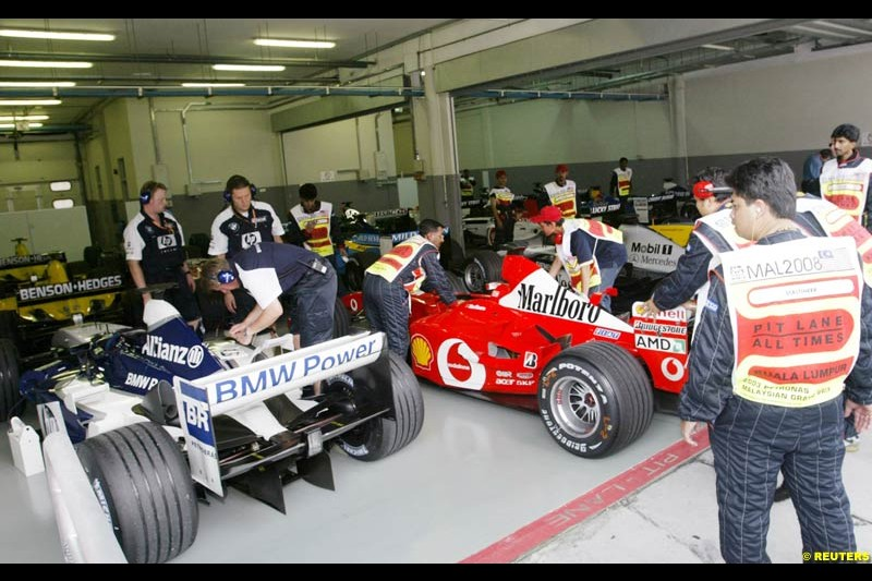 Cars taken to parc ferme after Saturday qualifying for the Malaysian GP. Sepang, March 22nd 2003.