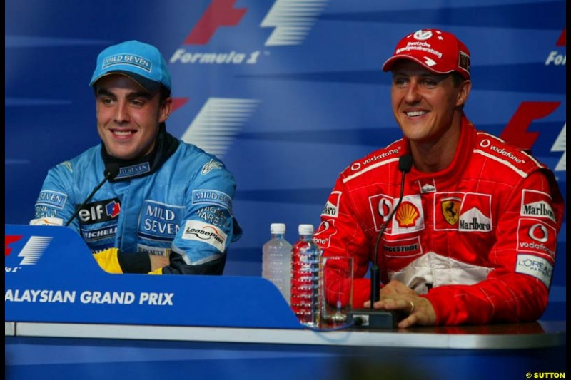Fernando Alonso, Renault, and Michael Schumacher, Ferrari, at the Post qualifying press conference. Saturday, Malaysian GP. Sepang, March 22nd 2003.