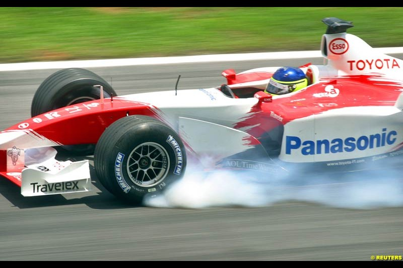 Cristiano da Matta, Toyota, during Saturday qualifying for the Malaysian GP. Sepang, March 22nd 2003.