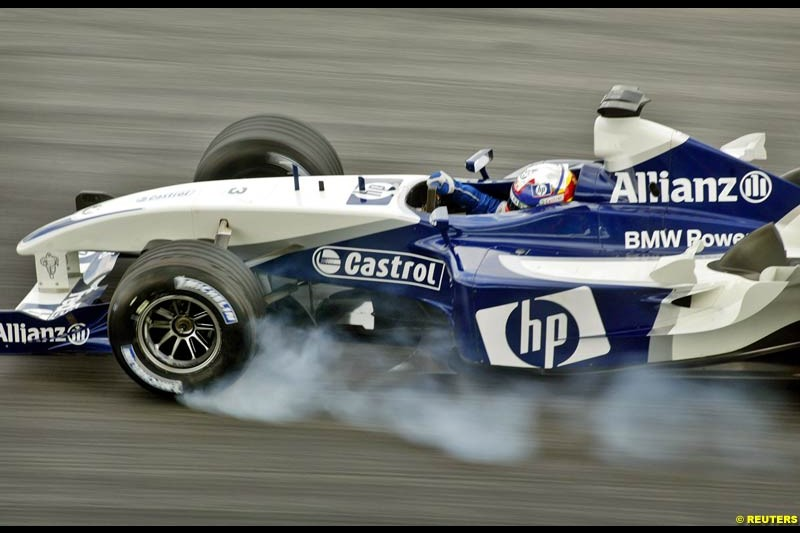 Juan Pablo Montoya, Williams, during Saturday qualifying for the Malaysian GP. Sepang, March 22nd 2003.